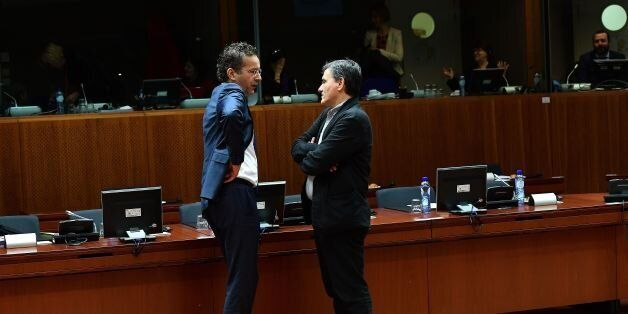 Eurogroup President and Dutch Finance Minister Jeroen Dijsselbloem (L) speaks with Greece's Finance Minister...