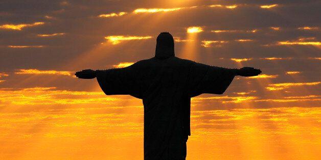 Christ the Redeemer during sunrise in Rio de Janeiro, Brazil, August 2, 2016. REUTERS/Kai