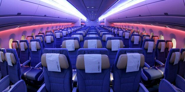 Light-emitting diode (LED) lights illuminate the economy class cabin of an Airbus A350 XWB aircraft, produced by Airbus Group NV, inside a Japan Airlines Co. (JAL) hangar during a media preview at Haneda Airport in Tokyo, Japan, on Thursday, Nov. 20, 2014. JAL ordered 18 A350-900 aircraft and 13 larger A350-1000s President Yoshiharu Ueki told reporters last year. Photographer: Kiyoshi Ota/Bloomberg via Getty Images
