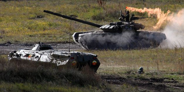 CHEBARKUL, RUSSIA - SEPTEMBER 27: Russian army tanks participate in the Center-2011 military exercises...