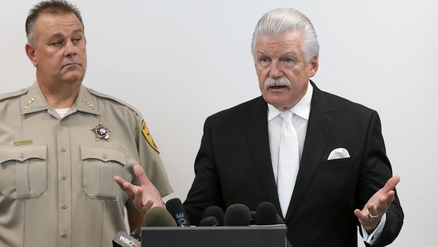 Will County State's Attorney James Glasgow, right, speaks at a news conference accompanied by Will County Sheriff Mike Kelley, Thursday, Sept. 19, 2019, in Joliet, Ill. Authorities have found no fetal remains at a shuttered abortion clinic once operated by the late abortion Dr. Ulrich Klopfer whose Illinois property was found to contain more than 2,200 medically preserved fetal remains.   (AP Photo/Teresa Crawford)