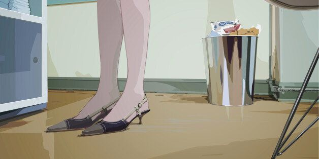 An illustration of a womans feet and lower legs standing in an office environment drawn from a low
