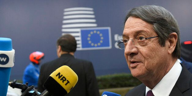 Cyprus' President Nicos Anastasiades addresses the media as he arrives for a European Union leaders summit...