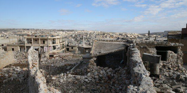ALEPPO, SYRIA - DECEMBER 18: Debris of the collapsed buildings is seen in the Darat Izza district of...