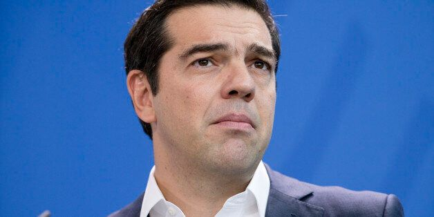 Greek Prime Minister Alexis Tsipras is pictured during a news conference held with German Chancellor...