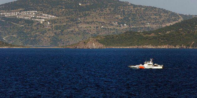 A Turkish Coast Guard vessel patrols the Aegean Sea, off the Turkish coast, Thursday, April 21, 2016,...