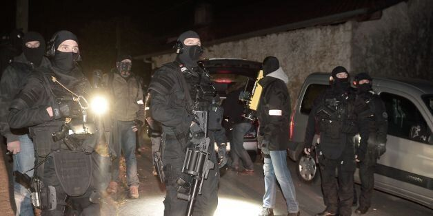 French police officers of the RAID and the Judiciary Police (PJ) secure the area after a French and Spanish...