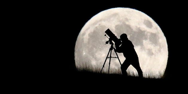 BRIGHTON, UNITED KINGDOM - SEPTEMBER 27: An astronomer stargazes ahead of tonight's supermoon on September...