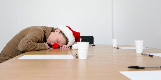 woman with santa hat asleep