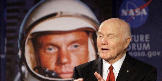 FILE - In this Feb. 20, 2012, file photo, U.S. Sen. John Glenn talks with astronauts on the International...