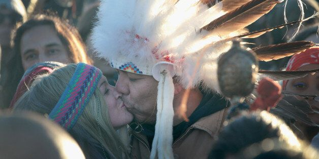 CANNON BALL, ND - DECEMBER 04: Native American and other activists celebrate after learning an easement...