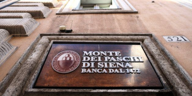 A sign hangs above the entrance to a branch of Banca Monte dei Paschi di Siena SpA bank after the Italian...