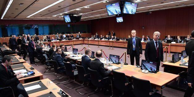 Eurogroup finance ministers wait prior to take part in a Eurogroup finance ministers meeting at the European...