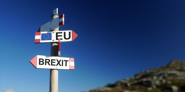 Brexit concept. Brexit and EU flag on mountain road