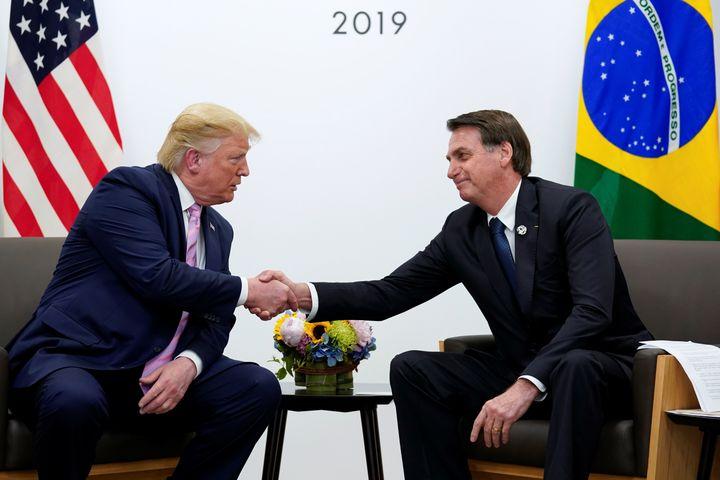 President Donald Trump andBrazilian President Jair Bolsonaro shake hands during a bilateral meeting at the G-20 leaders