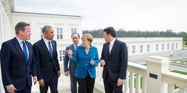 HANOVER, GERMANY - APRIL 25: German Chancellor Angela Merkel greets France's President Francois Hollande,...