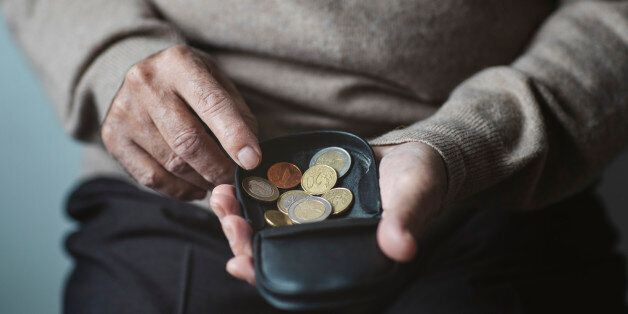 An elderly man look for some money from his