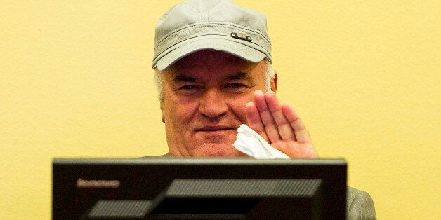 FILE - In this Friday, July 4, 2011, file photo former Bosnian Serb Gen. Ratko Mladic waves as he sits...