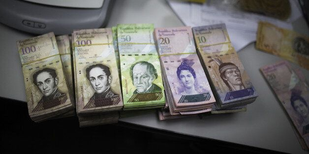 Bolivar notes separated for bank deposit are seen in the office of a bakery in Caracas, Venezuela, on...
