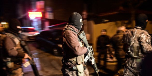 Turkish special force police officers patrol streets after a car bomb exploded near the stadium of football...