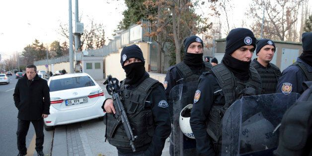 Turkish police officers stand guard as a group of pro-Palestinian stage a protest outside the Israeli...