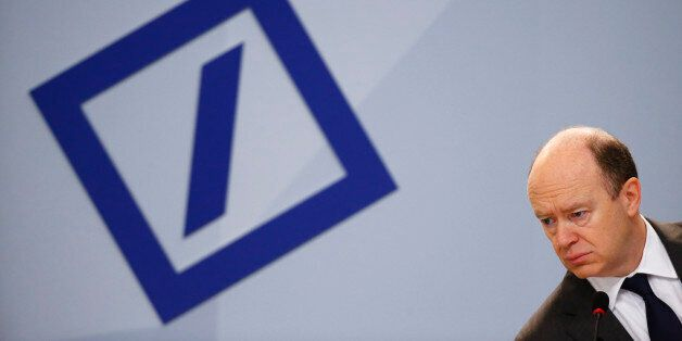 Deutsche Bank Chief Executive John Cryan attends a news conference in Frankfurt, Germany, January 28,...