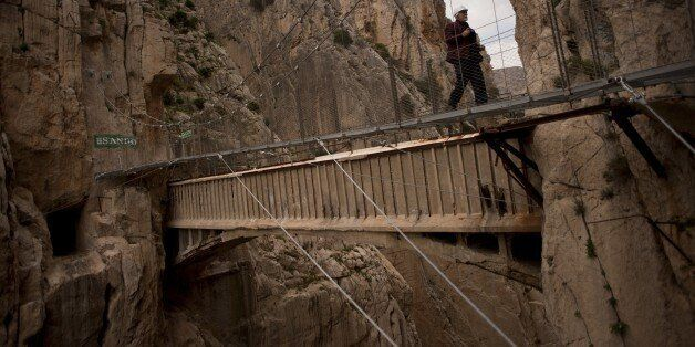 A man crosses a footbridge during a visit to the foot-path 'El Caminito del Rey' (King's little path)...