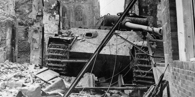 World War II, A German 'Tiger' tank destroyed, in the ruins of Argentan (Normandy), In the back, the...