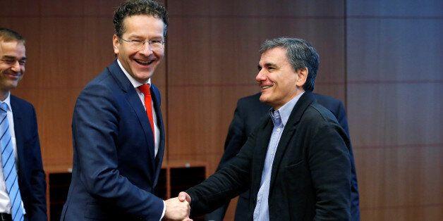 Dutch Finance Minister and Eurogroup President Jeroen Dijsselbloem greets Greek Finance Minister Euclid...