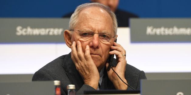 German Finance Minister Wolfgang Schaeuble gives a phone call during the Christian Democratic Union (CDU)...