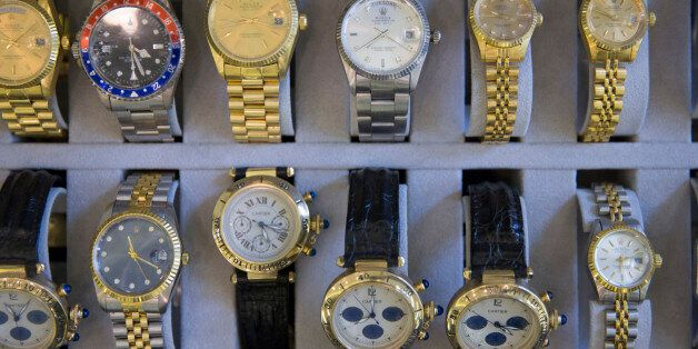Confiscated fake watches are displayed during the German customs annual news conference in Berlin, March...