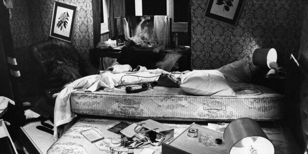 A bedroom that has been ransacked by