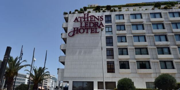 A man walks past the luxury Athens Ledra Hotel following its closure on June 2, 2016. The Athens central Athens Ledra Hotel, announced the closure of the 314-room establishment, citing 'financial difficulties'. More than 150 Athens Ledra employees have not been paid since March. / AFP / LOUISA GOULIAMAKI (Photo credit should read LOUISA GOULIAMAKI/AFP/Getty Images)
