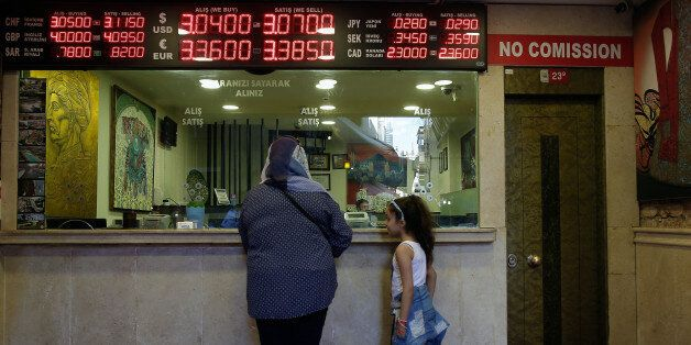 A board shows exchange rates at a foreign currency shop in central Istanbul, Thursday July 21, 2016....