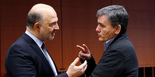 European Economic and Financial Affairs Commissioner Pierre Moscovici speaks to Greek Finance Minister...