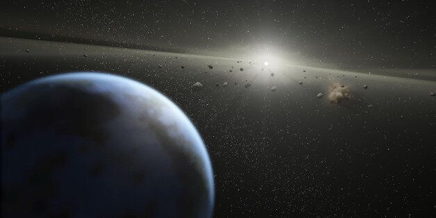 SPACE - UNDATED: An artists impression showing an asteroid belt around a star similar in size to the...