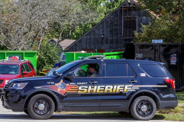 A Will County sheriff's patrol is stationed outside the home of the late Dr. Ulrich Klopfer on Thursday in a village south of