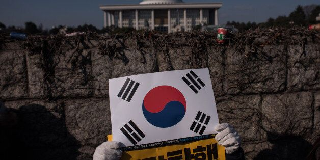 Protesters gather outside the National Assembly to demand the impeachment of South Korean President Park...