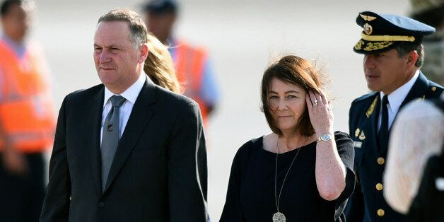 New Zealand's Prime Minister John Key and his wife Bronagh Key smile upon arrival at the Jorge Chavez...