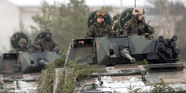 Polish Army soldiers take part in the NATO military exercise 'Iron Sword 2016' at a training range in...
