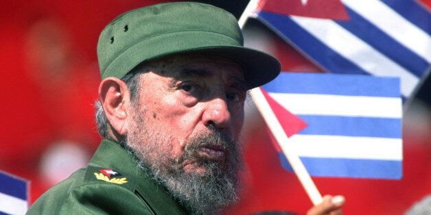 Then Cuban President Fidel Castro glances over his shoulder during the May Day commemoration at Revolution...