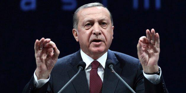 Turkey's President addresses police officers in Ankara, Turkey, Tuesday, Nov. 22, 2016. Turkey's government...