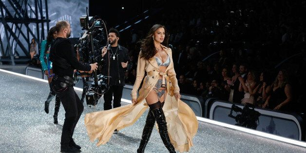 PARIS, FRANCE - NOVEMBER 30: Irina Shayk walks the runway as The Weeknd performs during the 2016 Victoria's...
