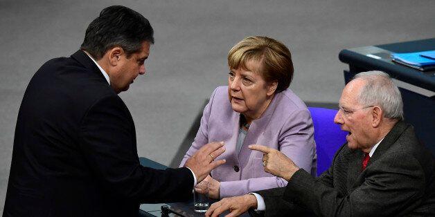 German Vice Chancellor, Economy and Energy Minister Sigmar Gabriel (L), German Chancellor Angela Merkel...