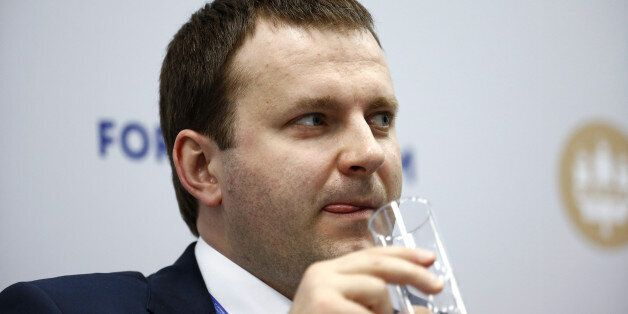 Maxim Oreshkin, Russia's deputy finance minister, takes a drink during a panel session on day two of...