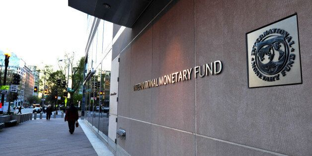 The International Monetary Fund (IMF) building sign is viewed on April 5, 2016 in Washington, DC.This...