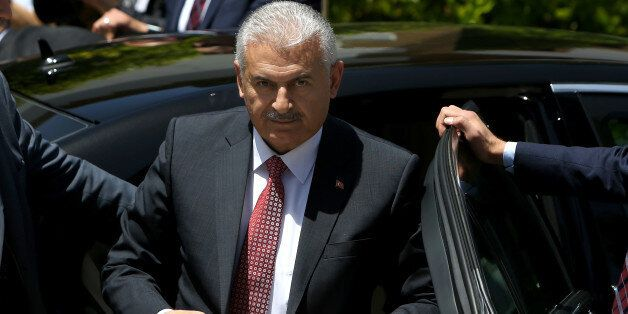 New Turkish Prime Minister Binali Yildirim adjusts his jacket as he arrives for a meeting with the Turkish...