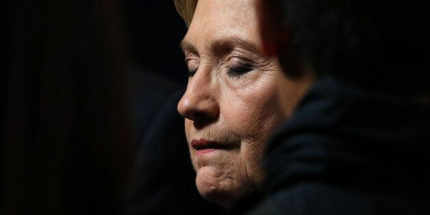 Hillary Clinton closes her eyes as she greets members of her staff and supporters after speaking about...