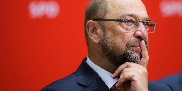 European Parliament President Martin Schulz, of the Social Democrats listens to party chairman Sigmar...