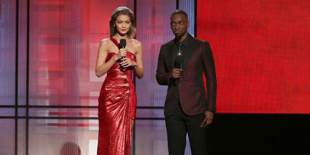 Hosts Gigi Hadid, left, and Jay Pharoah speak at the American Music Awards at the Microsoft Theater on...